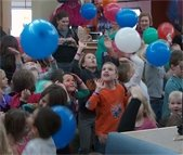 Kids hitting balloon in air