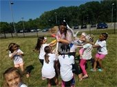 campers playing with fun conductor