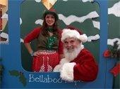 Santa and Elf on train